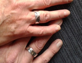 Wedding ring with two fingerprints